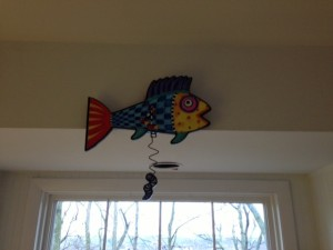 Ed's love of fish comes from his days of working at an aquarium in southern California. This fish clock says it's always time to read in this house.