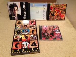 """Some of the CDs featured on the """"Mostly Folk World Tour,"""" November 3, 2103."""