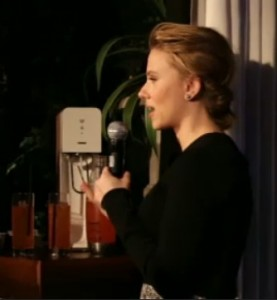 Scarlett Johansson enjoys a fizzy fruit drink.