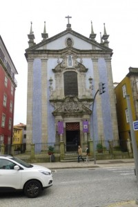The parish church of Sao Nicolau in Porto has a banner for Holy Week, but most people in Portugal consider this a time for family togetherness.