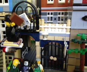 "Lego Fernando Pessoa escapes his captors on a volume of Pablo Neruda's poems, shouting, ""Books can take you anywheeerrre..."""