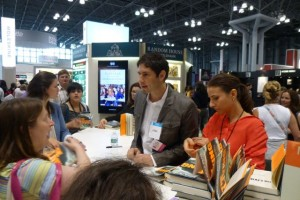 Matt de la Peña signs books after the panel.