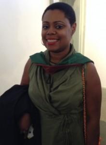 Ibi Zoboi, MFA, with her hood and diploma.