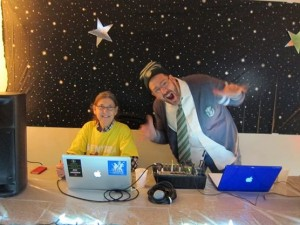 Classmate Rob Costello and I DJ'ing the party at the winter 2012 VCFA residency. Photo by Shelby Hogan.