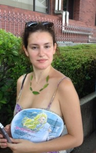 """World traveler Maddy with her new """"necklace,"""" waiting for a tour boat."""