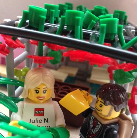 Day 4 of Sukkot: LEGO representative Julie N. Broberg takes a break from ComicCon to shake the lulav while Hipster holds the etrog.