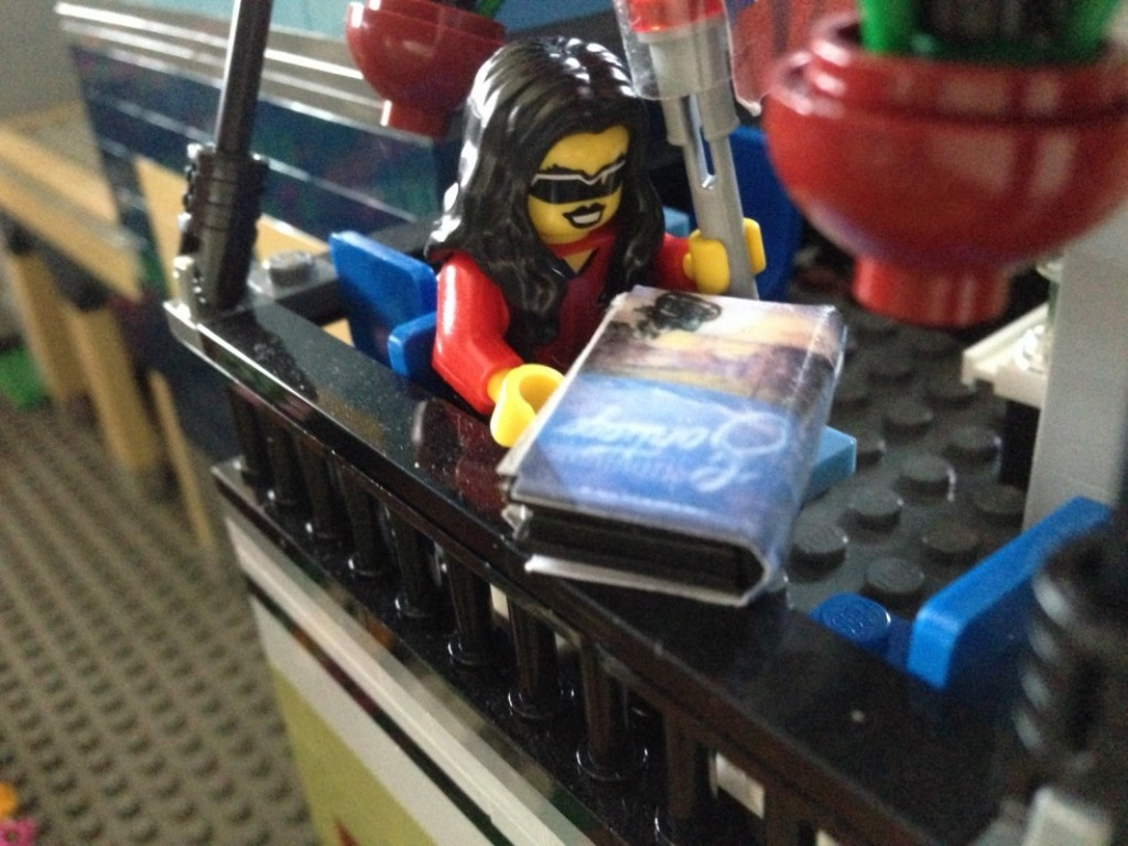 Lego Tina reads her ARC at an upstairs table of the Parisian Restaurant.