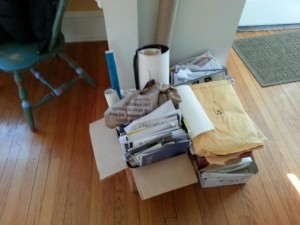 This pile includes three copies of my first novel manuscript, on its way to the shredder.