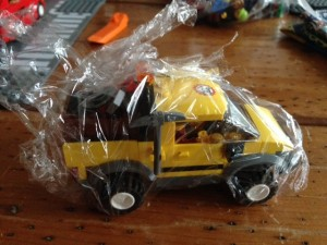This mining truck had a lot of small pieces. By shrink-wrapping them, I could keep them all together.