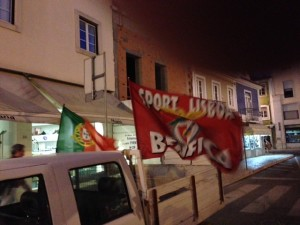 Flags and honking cars celebrate Benfica's clinching the national championship, the 34th in the club's history.