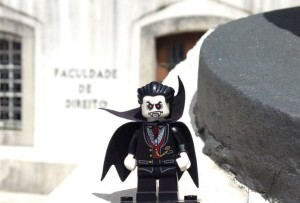 Our law professor wears the traditional black suit and cape of the university.