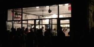 Long line at Morgenstern's just before closing. Hope they all get in.