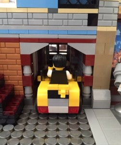 The radio station manager has his own basement parking space in my modular building MOC.