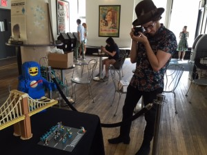 A professional photographer from the PR company associated with the LEGO Brickumentary at the Angelika Film Center.