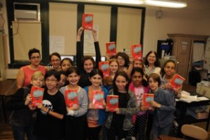 Students with their copies of Rogue. Photo by Susan Korchak.