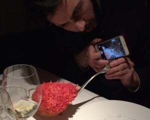 Derrick sets up a selfie for his souvenir crab at Al Covo.