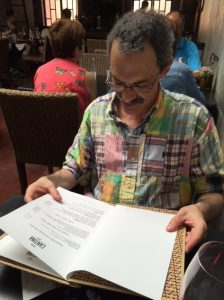 Richard checks out the menu at Cantina 32 in Porto.